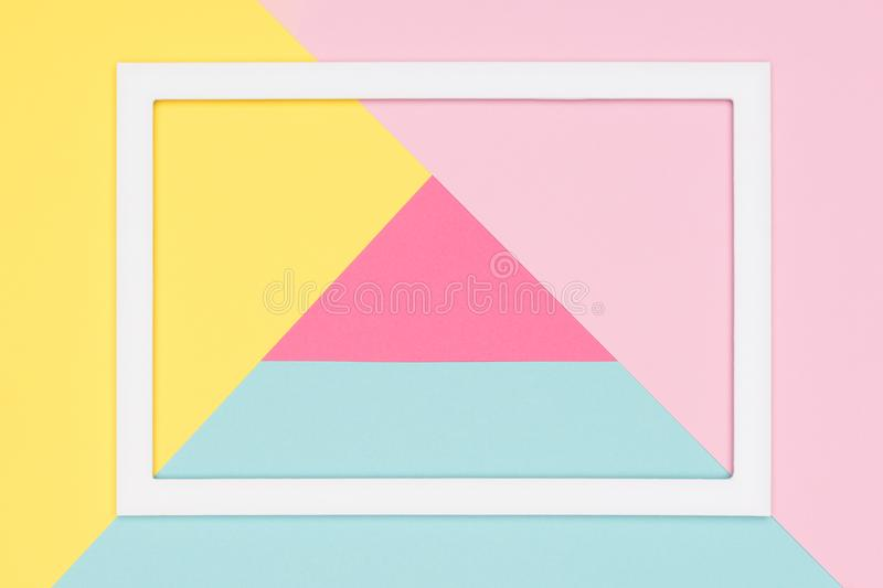 Abstract geometrical pastel blue, pink and yellow paper flat lay background. Minimalism, geometry and symmetry template. stock photos