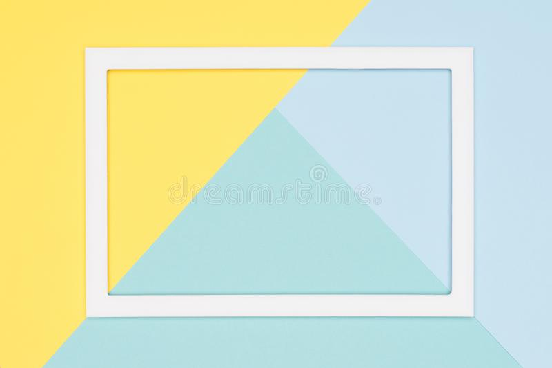 Abstract geometrical pastel blue, teal and yellow paper flat lay background. Minimalism, geometry and symmetry template. Abstract geometrical pastel blue, teal stock image
