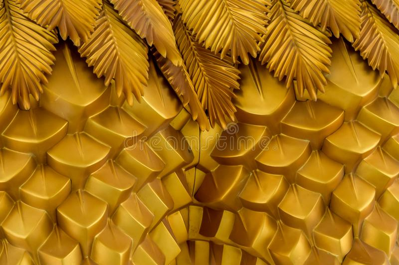 Abstract geometrical wavy background from golden metal with ethnic patterns. royalty free stock images