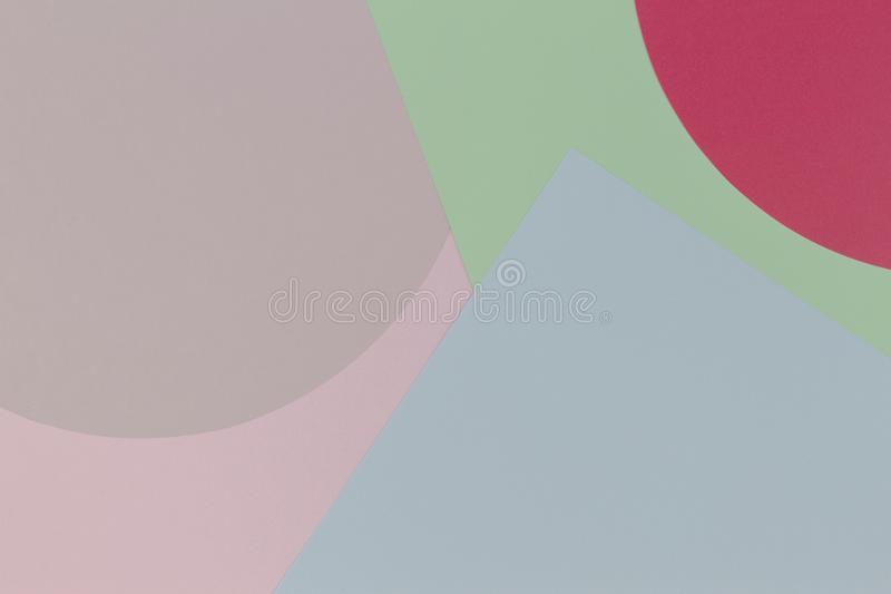 Abstract geometry color paper background with pastel pink, blue, green and red colors. Top view, flat lay stock photo