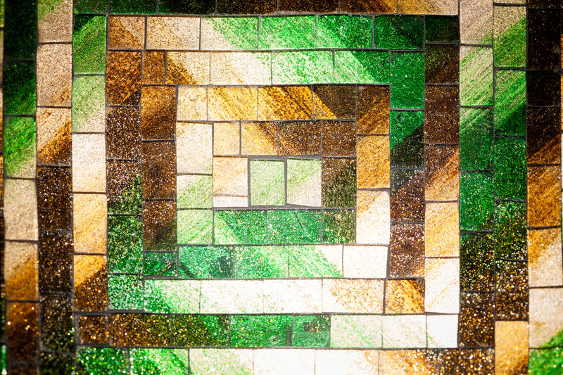 Abstract glass mosaic background green brown tone. Abstract colorful rectangle glass mosaic background green and brown tone with block pattern stock images