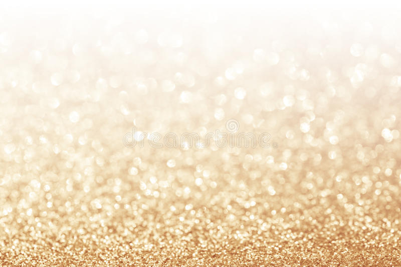 Abstract glitter gold background stock image