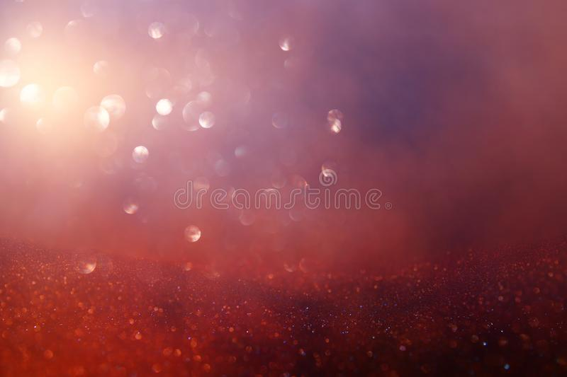 Abstract glitter lights background. red, black, purple and gold. de-focused.  stock photography
