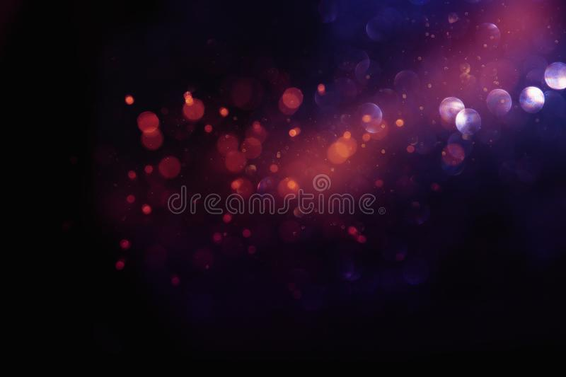 Abstract glitter lights background. red, black, purple and gold. de-focused.  royalty free stock photography