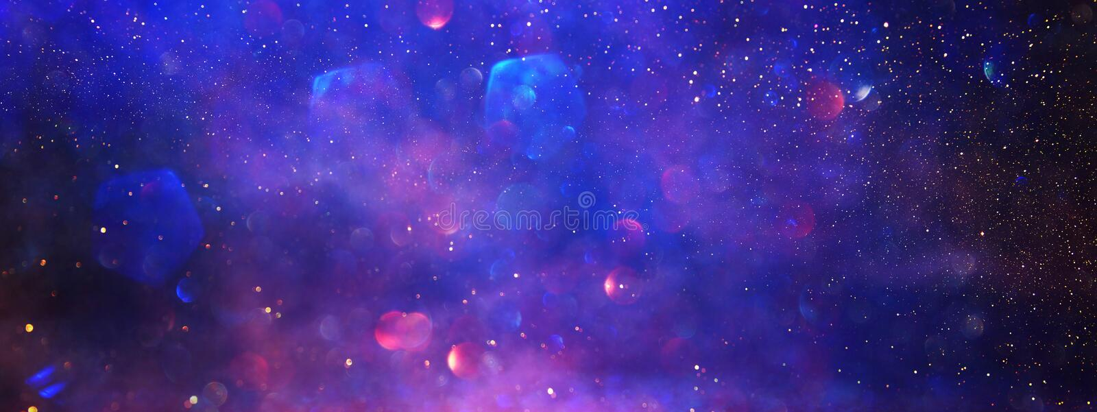 Abstract glitter silver, purple, blue lights background. de-focused. banner stock images