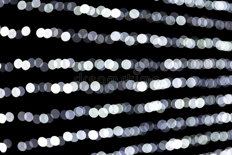 Abstract glitter sparkle bokeh defocused on black background. many round light on background stock photography