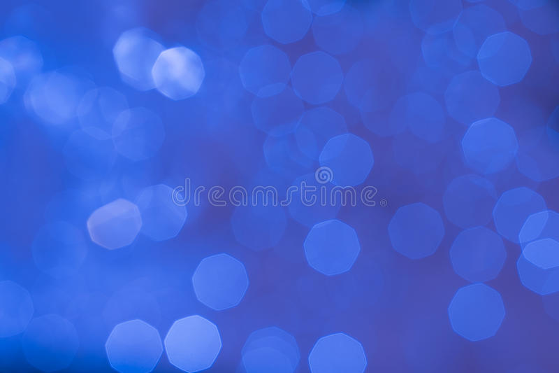 Abstract glittering blue bokeh background. Abstract glittering cobalt blue bokeh background defocused stock image