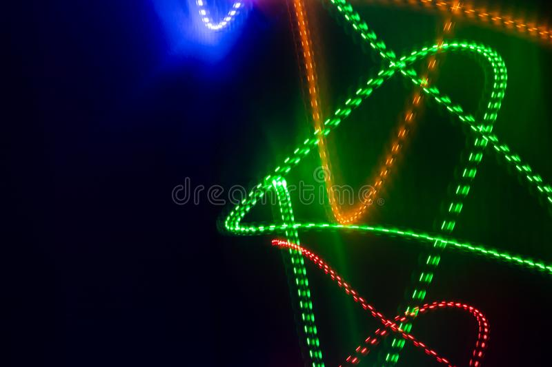 Abstract glowing  neon lines on black background. stock images
