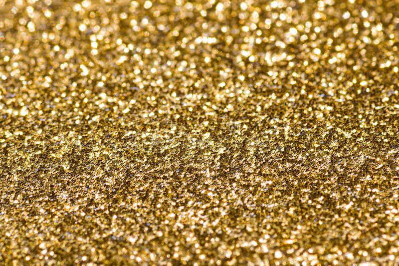 Abstract gold background with copy space. Glitter and bokeh. Christmas and new year concept royalty free stock photos