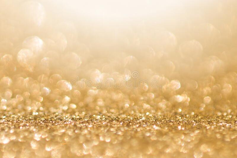 Abstract gold background with copy space. Glitter and bokeh. Christmas and new year concept royalty free stock photo