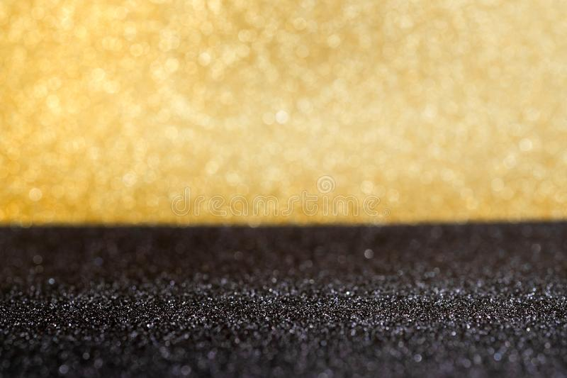 Abstract gold and black sparkling bokeh wall and floor background studio.luxury holiday backdrop mock up for display of product o. R content.festive greeting stock images