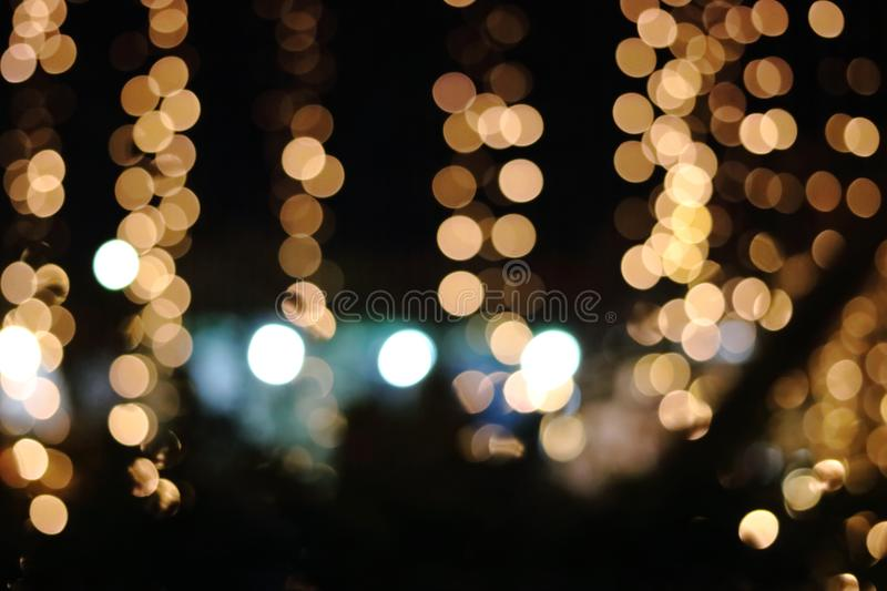 Abstract gold bokeh on dark background, Christmas blurred background stock photography