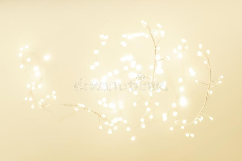 Abstract Gold Christmas Winter Background with festive glowing bokeh lights, copyspace stock image