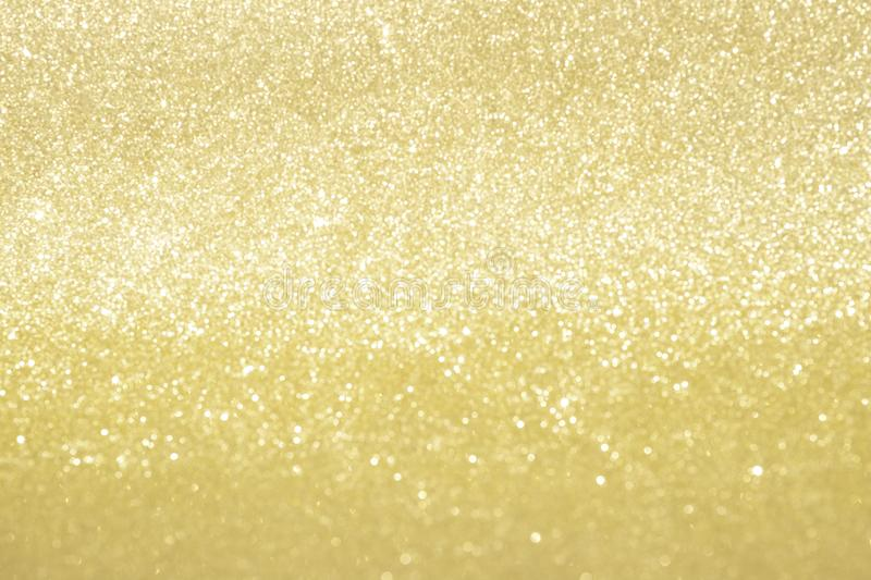 Abstract gold glitter bokeh lights with soft light background royalty free stock photo