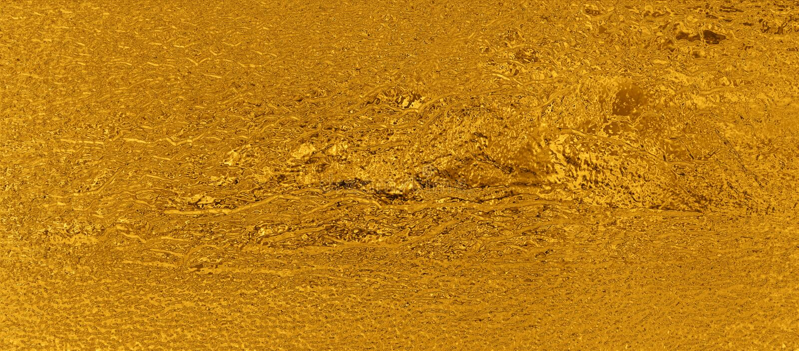 Abstract gold pattern bronze color closeup. royalty free stock image