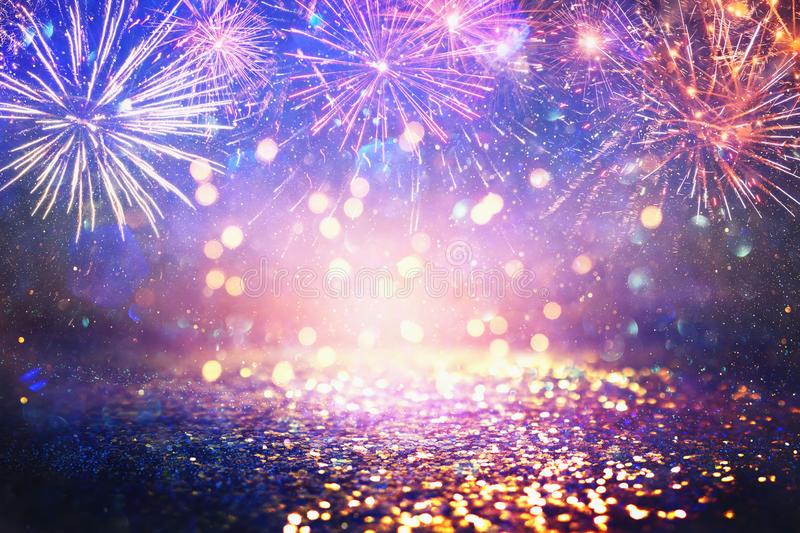 Abstract gold, purple and blue glitter background with fireworks. christmas eve, 4th of july holiday concept stock image