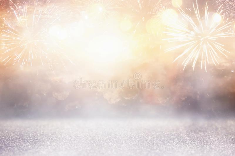 Abstract gold and silver glitter background with fireworks. christmas eve, 4th of july holiday concept. Abstract gold and silver glitter background with stock photo