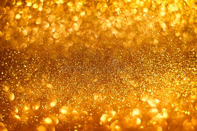 Abstract gold sparkles shiny defocused gold bokeh lights background use us gold luxury background for card, flyer royalty free stock photo