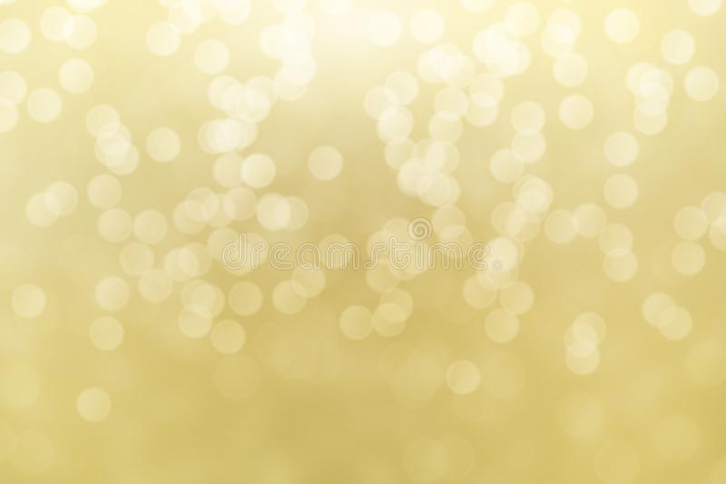 Abstract golden bokeh lights effect, soft blurred background.  royalty free stock photography
