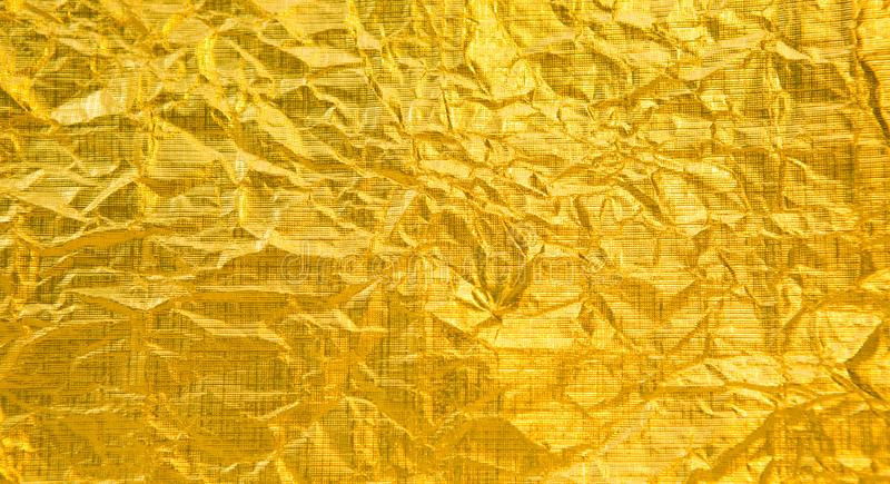 Abstract golden foil background royalty free stock photo
