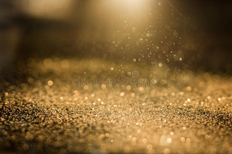 Abstract golden glitter. Gold glitter glittering background holiday shine royalty free stock image