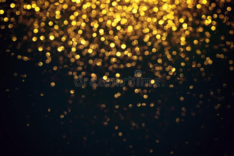 Abstract Golden Light Bokeh on black Background royalty free stock photos