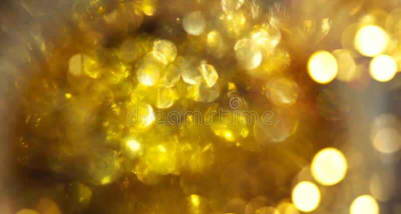 Abstract gouden achtergrond Golden vakantiegragende achtergrond Gedefocleerde achtergrond met koppelingssterren Blurred Bokeh royalty-vrije stock foto's