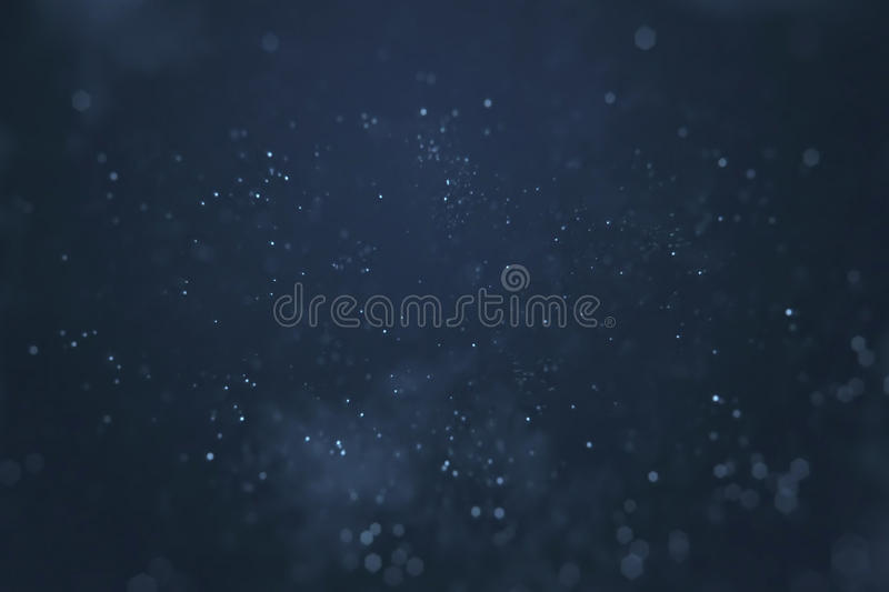 Abstract gradient blue background with bokeh and particles flowing, events festive holiday overlay ready. Concept royalty free stock images