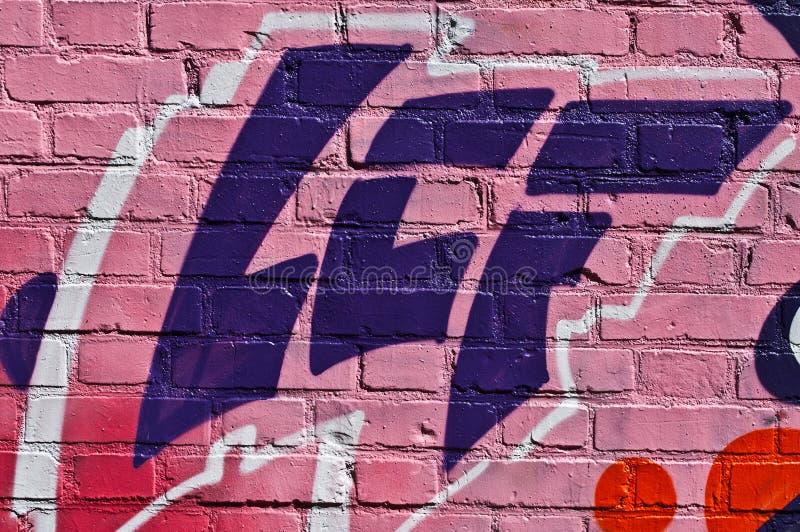 Abstract graffiti on brick background royalty free stock image