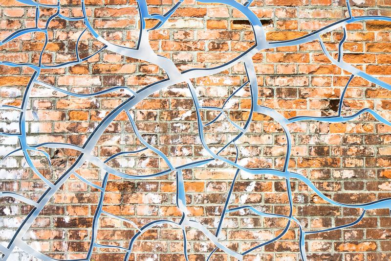 Abstract graphic image with cloudy sky behind a cracked brick wa. Ll stock photos