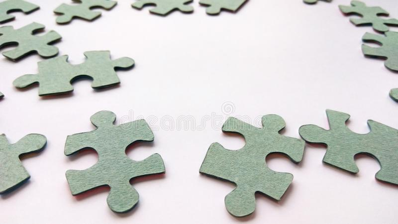 Abstract gray jigsaw puzzle pieces on white background royalty free stock photo