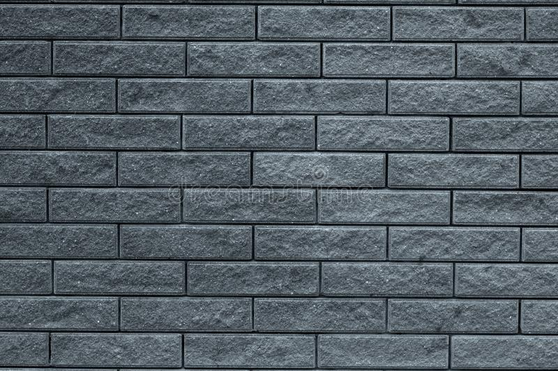 Abstract gray pattern of brick wall background. Light grey stone background. Grey bricks texture wallpaper backdrop of house facad royalty free stock photos