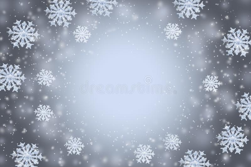 Abstract gray winter background with the snowflakes and copy space in the center. stock illustration