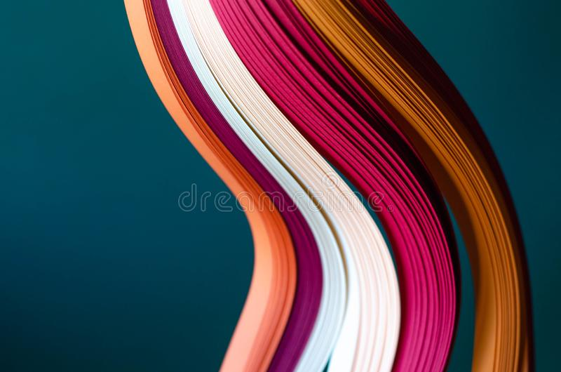 Abstract green background with orange, burgundy and white stripes. stock photos