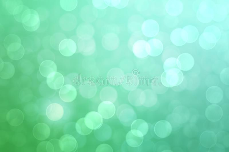 Abstract green bokeh lights effect, soft blurred background.  royalty free stock photography