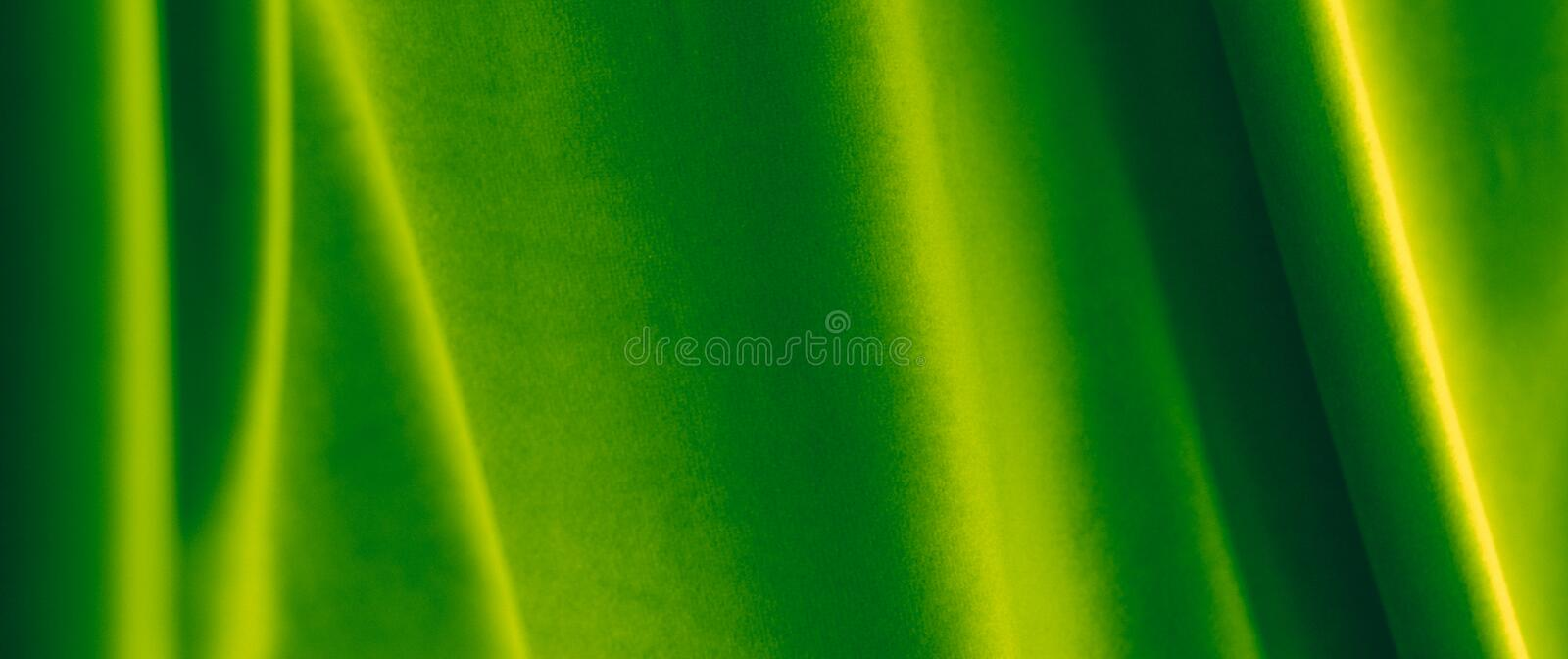 Abstract green fabric background, velvet textile material for blinds or curtains, fashion texture and home decor backdrop for. Decoration, branding and surface royalty free stock images