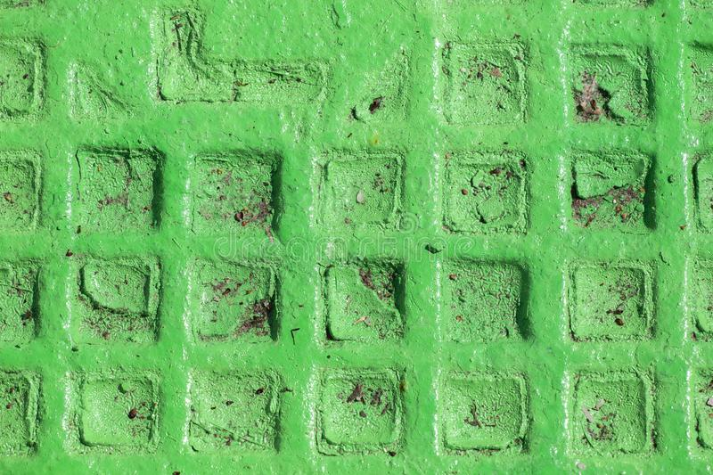 Abstract green industrial metal background texture with bolts and rivets. Old painted metal background Can be used as a background. Close-up stock photo