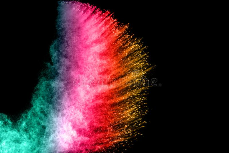 abstract green red yellow color powder explosion on black background stock photography