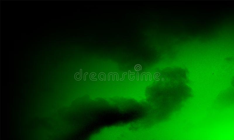 Abstract green smoke and black background. stock images