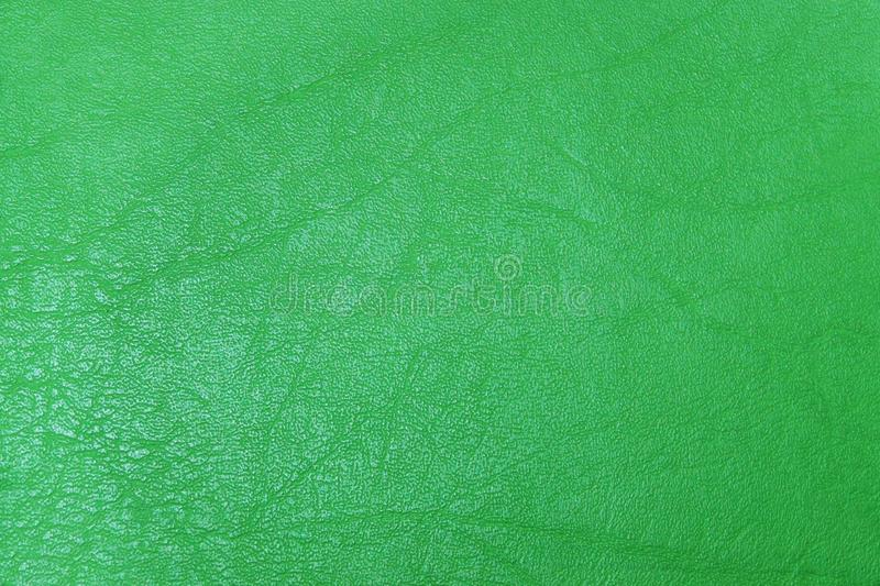 Abstract green textured leather background stock photography