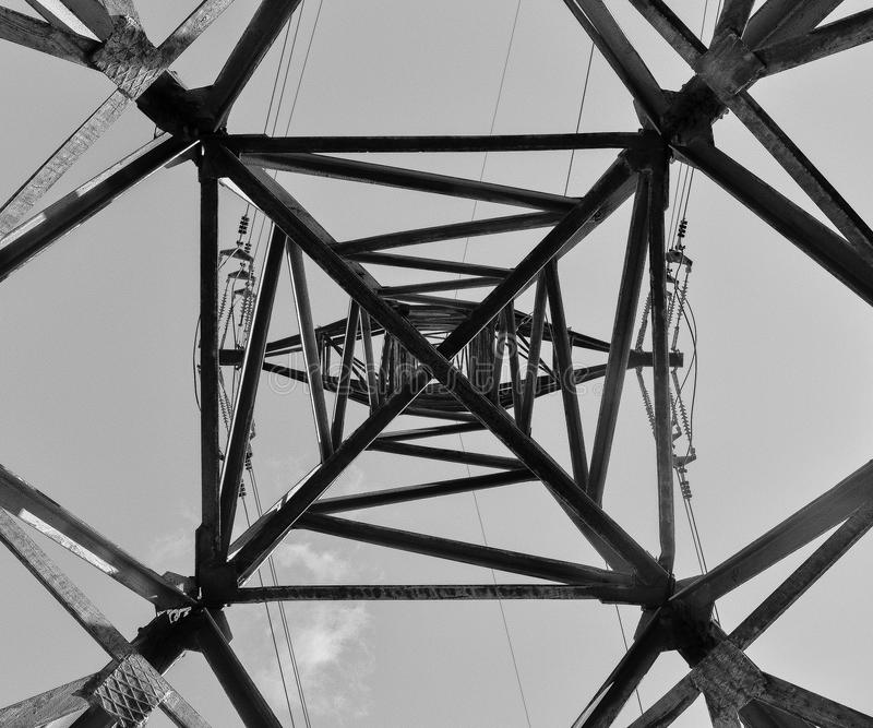 Abstract greyscale power line tower stock photos