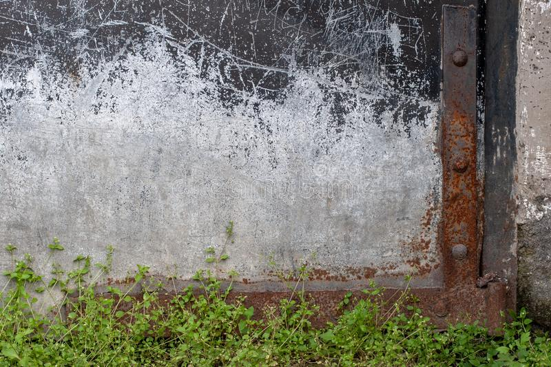 Abstract grunge background. The lower right side of the old garage door. stock photography