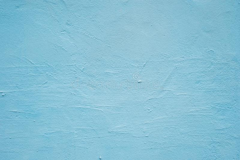 Abstract grunge decorative blue plaster wall background with winter pattern. stock photos