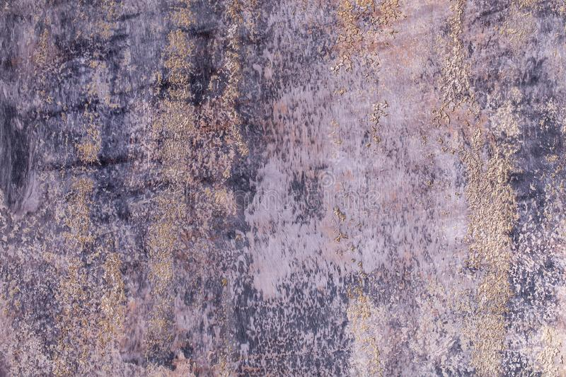 Abstract grunge decorative blue grey dark stucco with gold splashes wall background royalty free stock photo