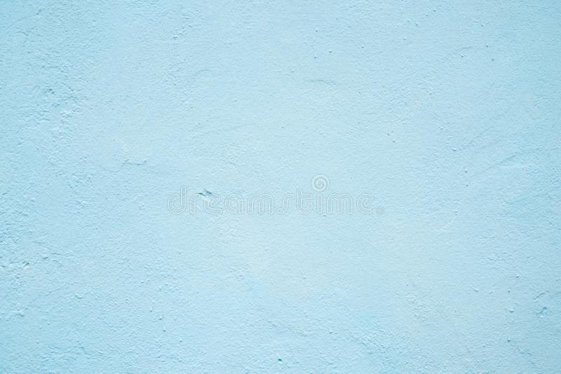 Abstract grunge decorative blue plaster wall background with winter pattern. royalty free stock photo