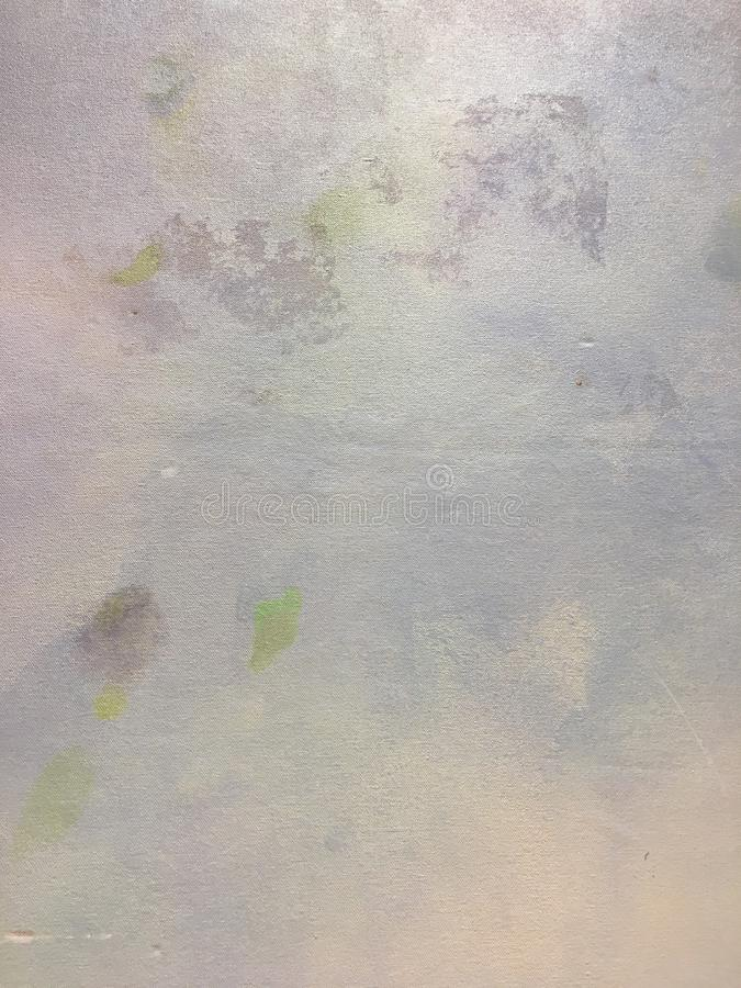 Abstract grungy soft purple and grey pastel painted background stock photo