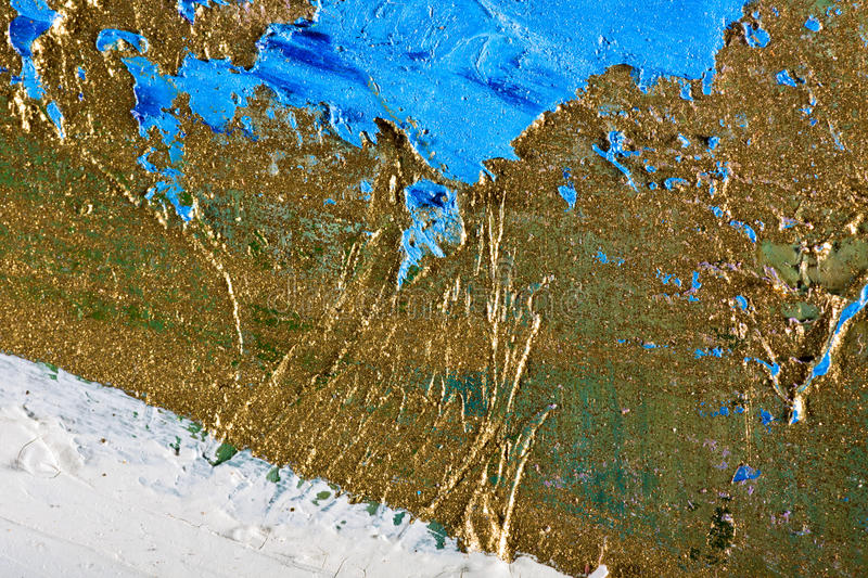 Abstract hand painted background. Art abstract grunge golden background. Fragment of an original painting. Oil and mixed media on canvas stock images