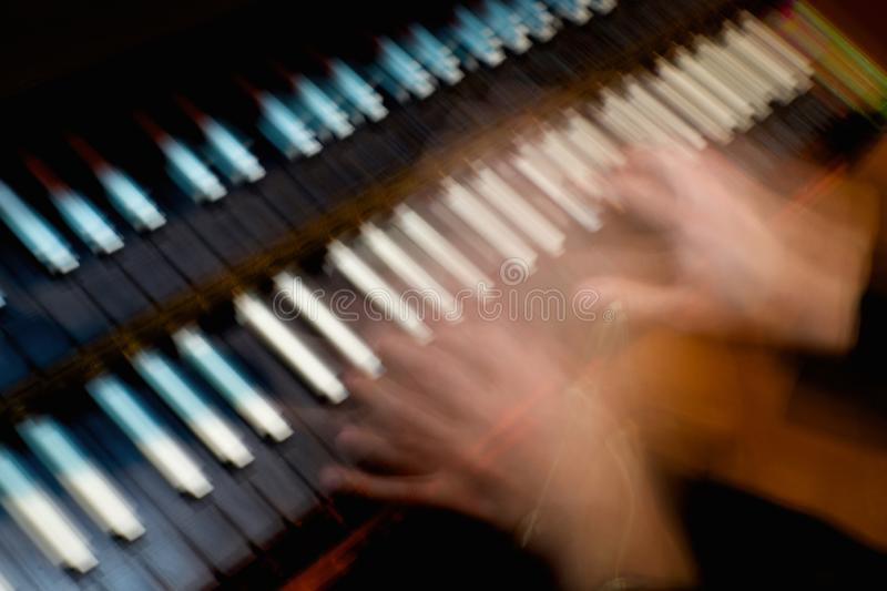 Abstract harpsicord being played. Abstract harpsichord being played hands royalty free stock photo