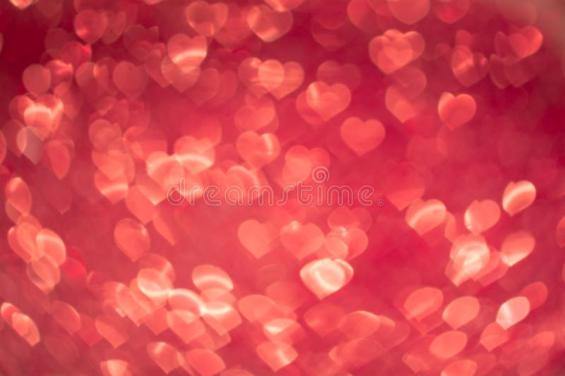 Abstract heart bokeh defocused red lights. Abstract heart bokeh defocused glitter red lights royalty free stock photos