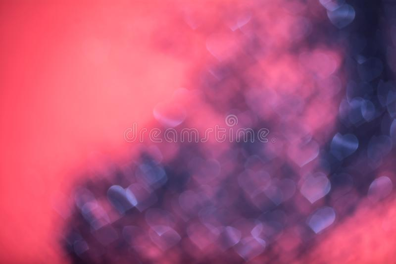 Abstract heart bokeh defocused red lights. Abstract heart bokeh defocused glitter red and blue lights royalty free stock photography